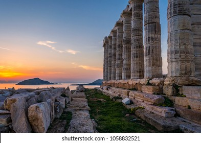 Sounion, Attica / Greece: Colorful sunset at Cape Sounion with the Temple of Poseidon. One of the Twelve Olympian Gods in ancient Greek religion and myth. God of the sea, earthquakes. Nobody, Aegean