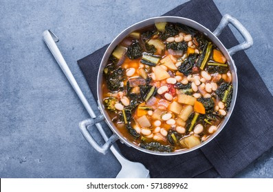 Soup with beans, kale, vegetables  top view.Vegetarian food.