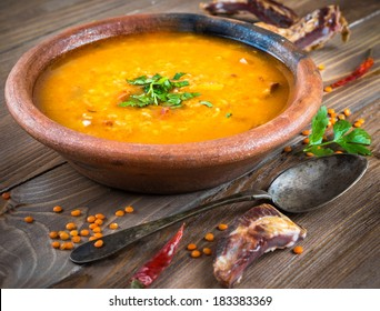 Soup of bulgur and lentils with smoked lamb ribs