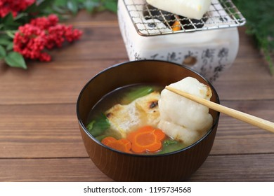 a soup containing rice cakes, eaten on New Year's day