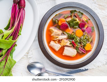 soup with fresh young beet in plate. studio shot