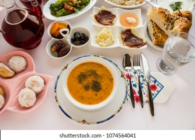 Soup is important element for iftar table.Traditional Turkish soup (Ezo gelin) on the Ramadan table with other symbolic foods.Top view,isolated.
