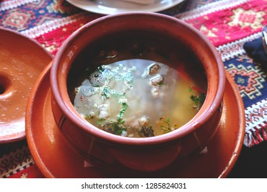 Soup khashlama. Traditional hot soup with lamb in a clay pot