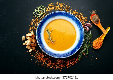 Soup of mashed red lentils. Close grain lentils, spices and herbs. Vegetarian concept