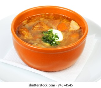 soup meat with mushrooms in a ceramic cup