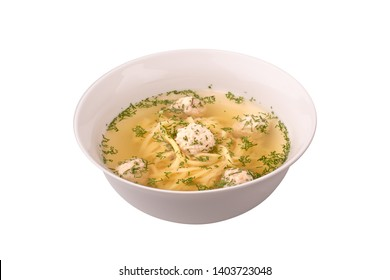 Soup with meatballs on the white background