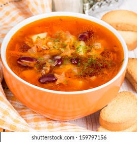Soup with meatballs, red beans and carrots