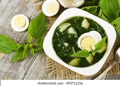Soup of nettles on the wooden table