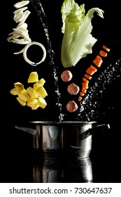 soup preparation, vegetables flying in the air above soup pan, black background, cooking