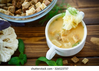 soup pureed cauliflower in a plate on the table