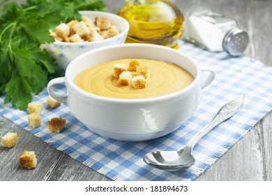 Soup of red lentils with croutons in the bowl