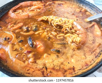 Soup rice with prawns and mussels
