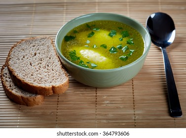 Soup with semolina dumplings and whole grain bread