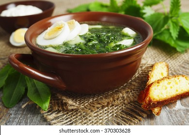 Soup of sorrel and nettles on the table