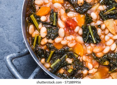 Soup with vegetables, beans, kale, top view.Typical tuscan soup, ribollita.
