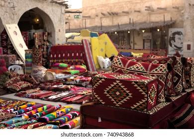 SOUQ WAQIF, DOHA, QATAR - OCTOBER 23, 2017: Textiles on sale in Souq Waqif in Qatar, Arabia.