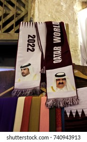 SOUQ WAQIF, DOHA, QATAR - OCTOBER 23, 2017: World Cup 2022 scarves on sale in the souq, with the portraits of the two most recent rulers