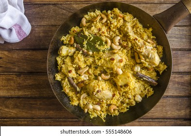 Sour berry chicken pulao in a pan
