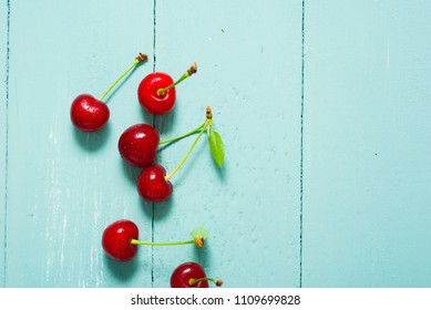 sour cherry fruits on old blue wooden table background