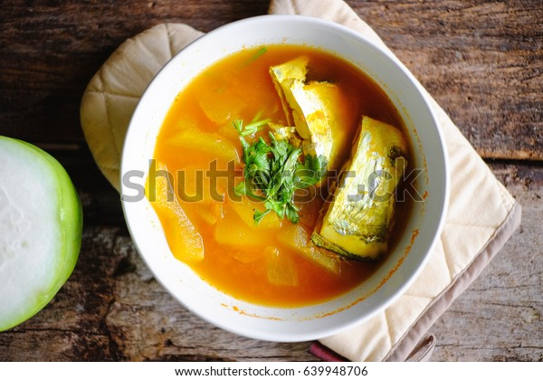 sour curry soup with sea fish and winter melon (kang som) .Thai cuisine