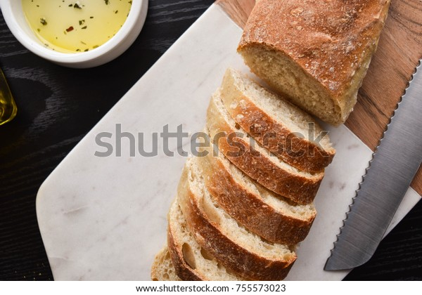 Sour dough bread and olive oil, top down food photography.