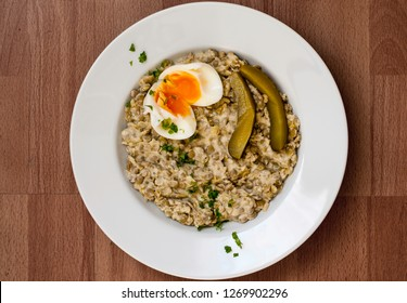 Sour lentils with egg and pickles