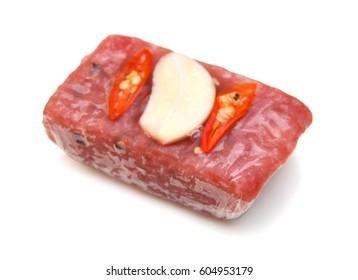 Sour pork : venamese northeastern style food which mixed pork rice garlic sugar and salt in banana leaf package.