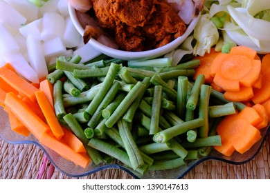 Sour red Curry Paste(sour soup made of tamarind paste Thai style )made by dried red chili, galangal, salt, garlic and shallot and vegetable ingredient white radish, yard long bean carrot and choy