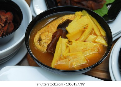 Sour soup of dry garcinia cambogia paste with bamboo shoot and fish slice.