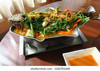 Sour soup with fried fish and mixed veggies made of tamarind paste, thai style foods, bangkok, thailand