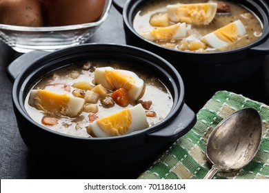 The sour soup made of rye flour with eggs on dish