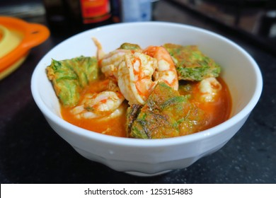 Sour soup made of tamarind paste with shrimp and  Fried Egg with Climbing Wattle, thai style traditional food