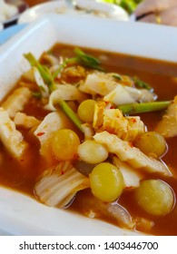 Sour soup made of Tamarind Paste add many eggs and vegetables in a white bowl