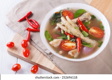 sour and spicy chicken feet soup