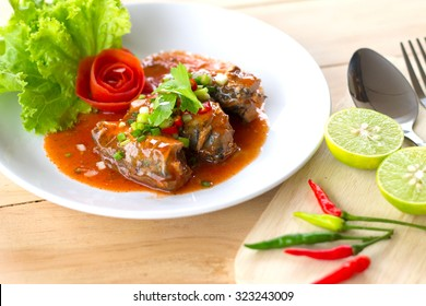 Sour and Spicy Sardines in tomato sauce salad. Thai food.