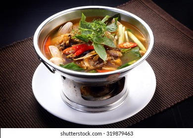 Sour and Spicy Smoked Dry Fish Soup in hot pot, isolated
