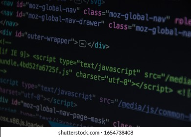 Source code or HTML code on screen of computer, Close up css code on monitor screen with black background, binary code on dark background