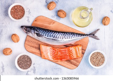 Sources of omega 3 - mackerel, salmon, flax seeds, hemp seeds, chia, walnuts, flaxseed oil. Healthy eating concept. Top view with copy space.
