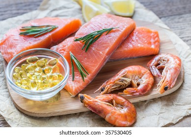 Sources of Omega-3 acid (salmon, shrimps, Omega-3 pills) on the