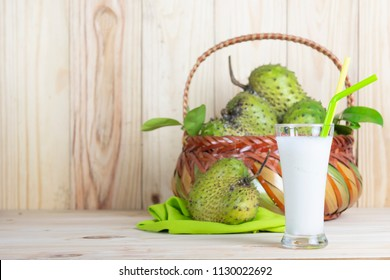 Soursop  basket and juice or Prickly Custard Apple or Annona muricata L on wooden table.