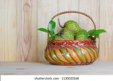 Soursop  basket or Prickly Custard Apple or Annona muricata L on wooden table.