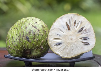 Soursop, Guanabana, Custard Apple, Annona muricata on nature background, close up . Island Bali, Ubud, Indonesia