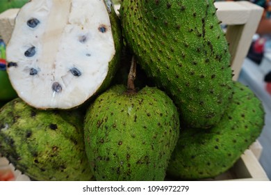 Soursop is a large edible fruit with white fibrous flesh.