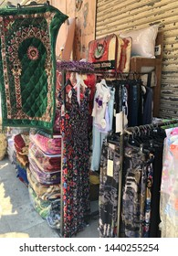 Sour(Tyre)/Lebanon-June 29,2019: clothes and rugs being sold in an old marketplace in Tyre-Lebanon