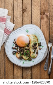 Sous vide egg with bread and wild mushrooms, copy space