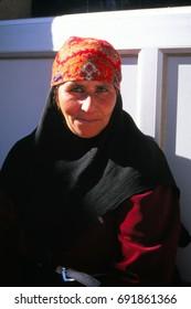 SOUSIA, SYRIA - NOV 8, 1996 - Local woman poses for her portrait in a village near  Aleppo, Syria