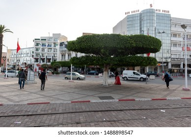 SOUSSE - TUNISIA, JUNE 15, 2019: Downtown of Sousse, Tunisia. People and Vehicles with shopping mall in background.