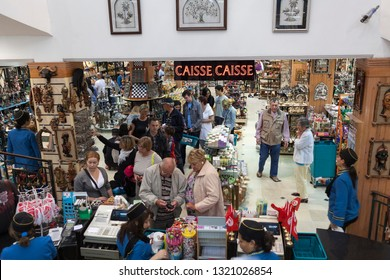 SOUSSE, TUNISIA-CIRCA MAY, 2012: Customers stand in queue to checkout lane in Yasmina souvenir center. Interior of large giftshop with lot of advertising gifts and national goods and products