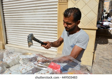 SOUSSE,TUNISIA - June 28,2016: Male Oriental sweets seller at a street market in the old Medina