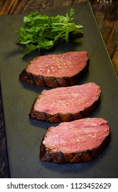 Sous-vide steak cut into pieces, cooked to eat beef on the stone table